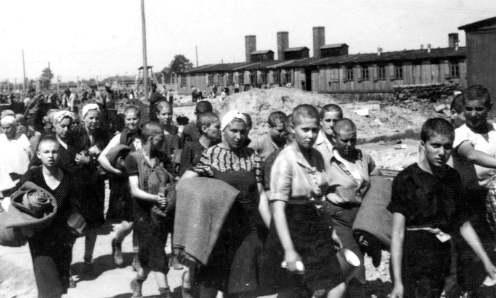 Jewish women from Carpathia, a region between Hungary and Ukraine, walking to the barracks at Auschwitz, May 1944. They were  part of the mass expulsion of rural Jewish communities which followed Germany's invasion of Hungary in March 1944.