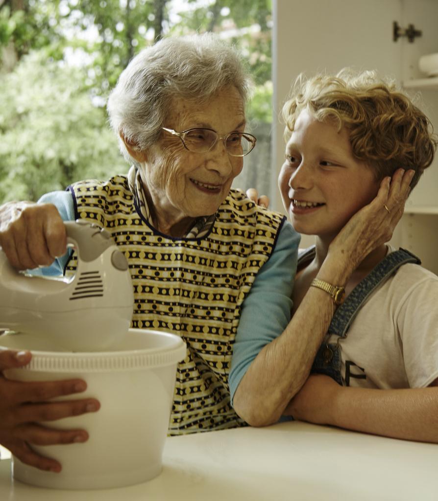 Thea Riesel preparing latkes with her grandson Jono Riesel.