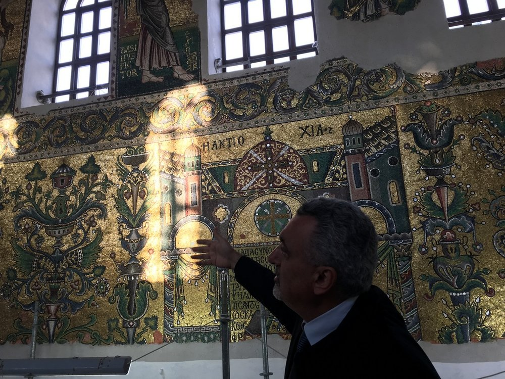 Ziad al Badkan, religious affairs adviser to Palestinian President Mahmoud Abbas, conducts a tour of the restoration for European diplomats. They had to climb the scaffolding to the roof to see the Crusader era mosaics.