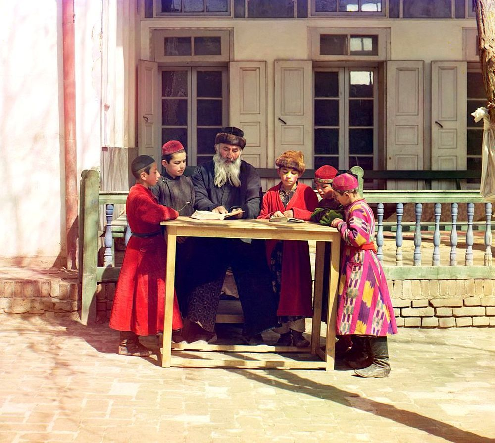 Jewish boys studying with their teacher, Samarkand, 1910. Photo by Sergei Prokudin-Gorskii, who travelled across Russia shooting in colour in the early 20th century. At that time, it was a complex process, involving photographing 3 different coloured plates, and joining the images later. As you can imagine,   his subjects had to sit very still...