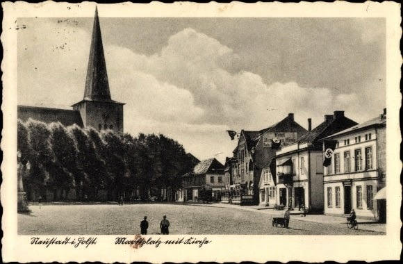A postcard of the town of Neustadt flying swastikas during WWII.