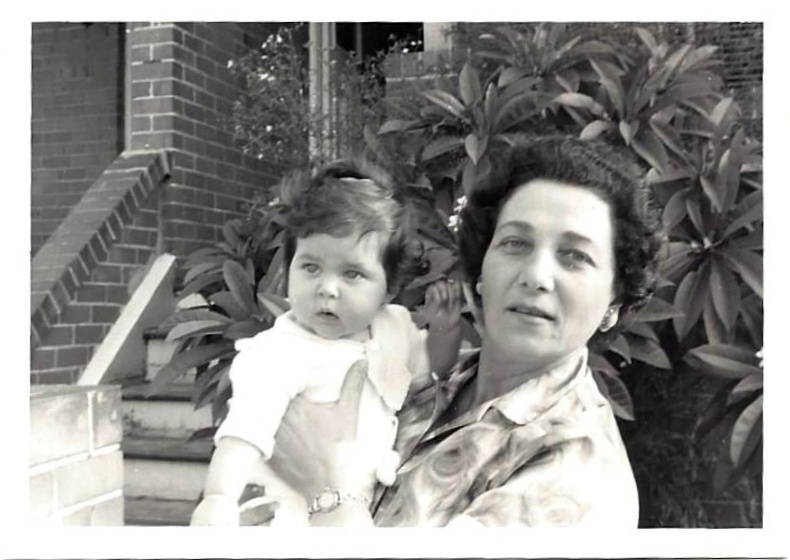 My grandmother holds me - her first grandchild! - outside the first home she owned in Bondi, Sydney, Australia.