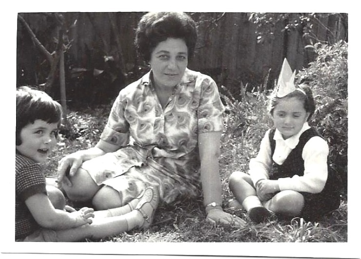 Me and my cousin Arli in the backyard with Grandmother Lea.