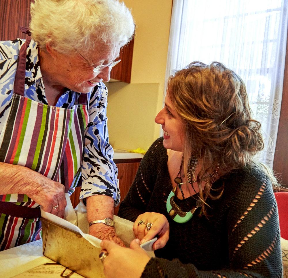 Saba Feniger baling honeycake in her Melbourne kitchen with her eldest grand-daughter Keren Dobia, 2015