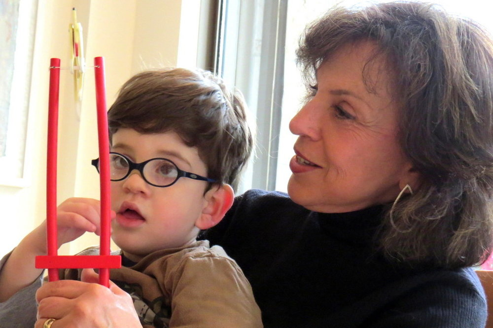 Mindy with her grandson Ely, one of her 6 grandchildren.