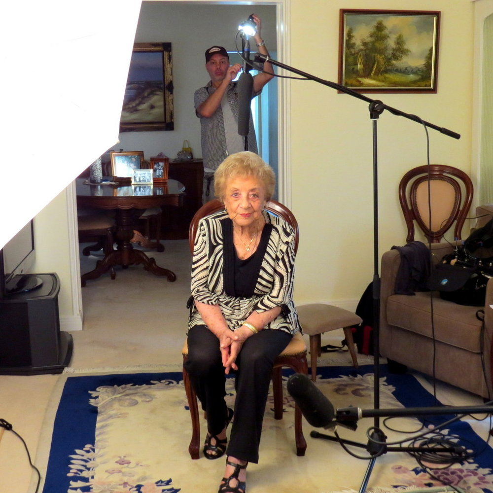 Warsaw Ghetto Survivor Lena Goldstein sitting in while we adjust the lights for ABC-TV Compass programme, 'Taste of Memory'