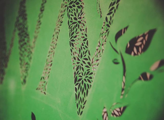 Close up on my papercut piece, on display at @presenttensefitness #rootdownriseup #handlettered #papercut #botanical