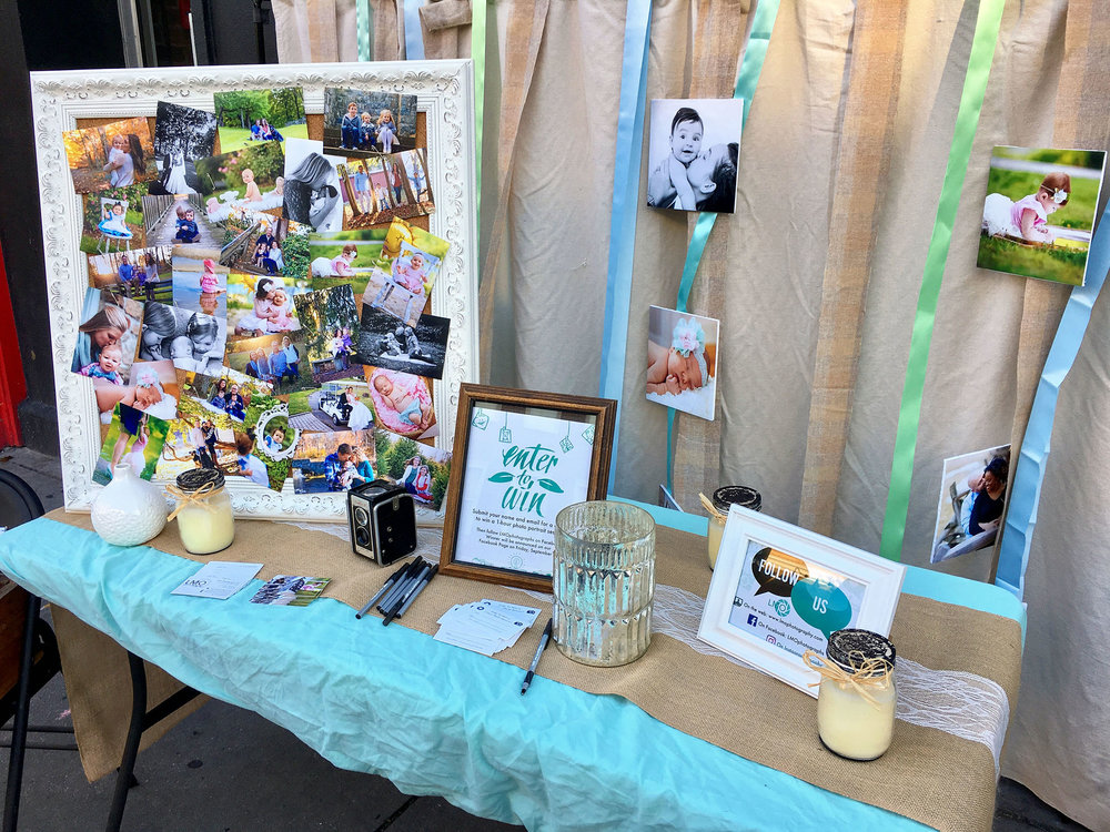 Here was our table: showing off our work, offering some of our landscape and artistic prints for sale, and holding a contest to win a free photo session. Big props to Liz for putting all these elements together to make our table look so good!
