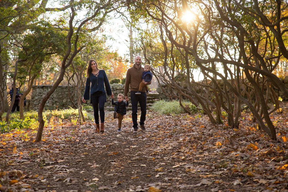 The Arielle family walks the laurel framed pathways at Cross Estate Gardens iN Bernardsville, NJ.