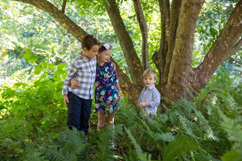 The Glenn siblings pose amongst the ferns at Cross Estate Gardens in Bernardsville, NJ.