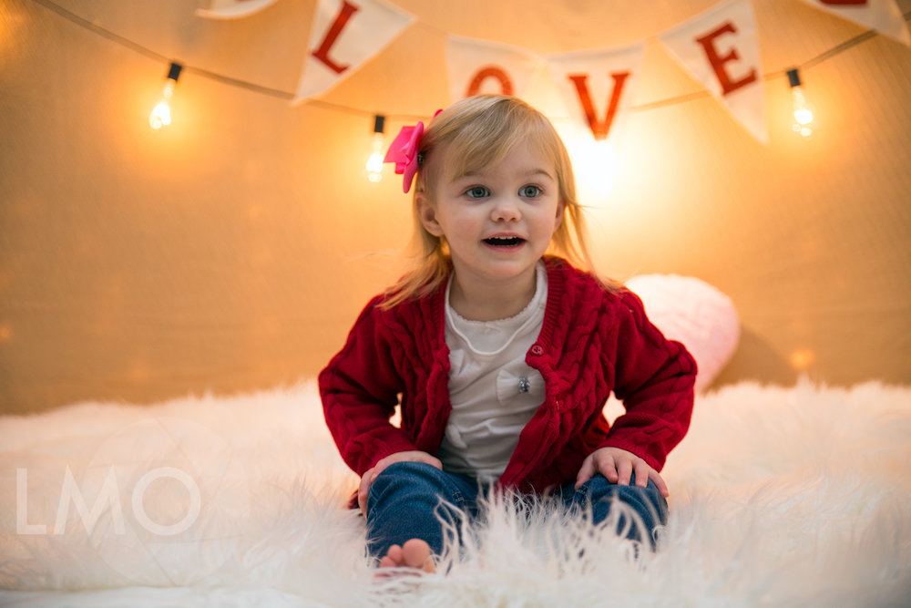 Scarlett shows off one of our Valentine setups. Our little girl is getting to be a little big!