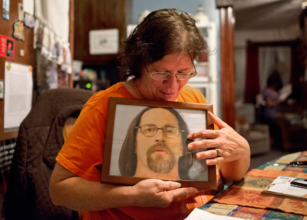 Sheryle Moore holds a photo of her husband Marty. She and her husband also met through an inmate essay program, and decided to meet after they formed a connection through their letters. Moore said Marty was on death row, but his sentence was changed to life in prison.  Their wedding ceremony was held in July of 2011 in Menard Correctional Center. Moore moved from Indiana with 86 dollars in her pocket to be closer to Marty, and has been staying at the Hospitality House under the condition that she help with finances and household chores.