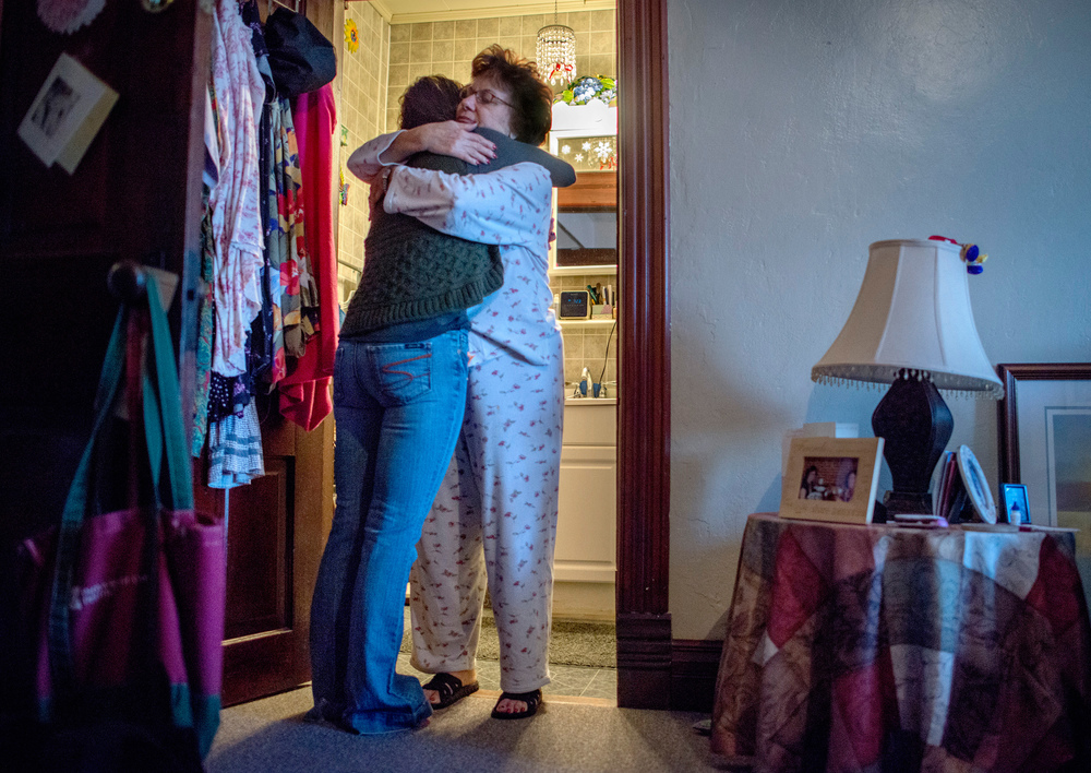 "Gayle comforts Kellie before she goes to see her husband at Menard Correctional Center. ""When these people come to my house they are all walking in my exact shoes,"" she said, ""Unless you have the experience of loving somebody in prison, no matter if its your son; your father;  your husband, you just have no comprehension of what it's like."""