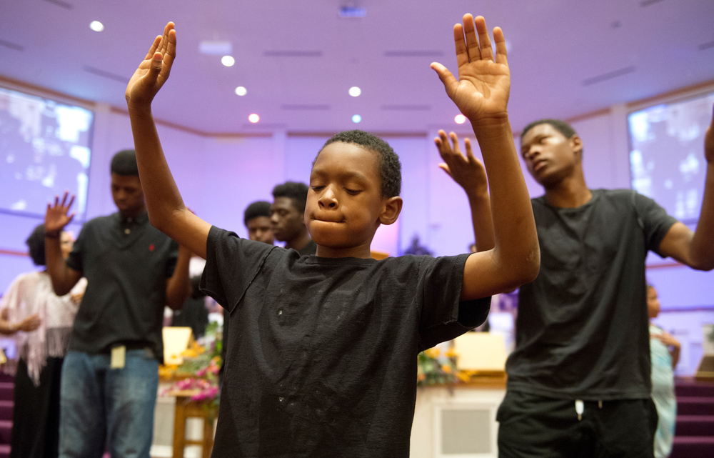 Rayshard Pettway, 10, dances with Divine Urban Expressions during a cancer survivor celebration Thursady, Sept. 24, 2015.