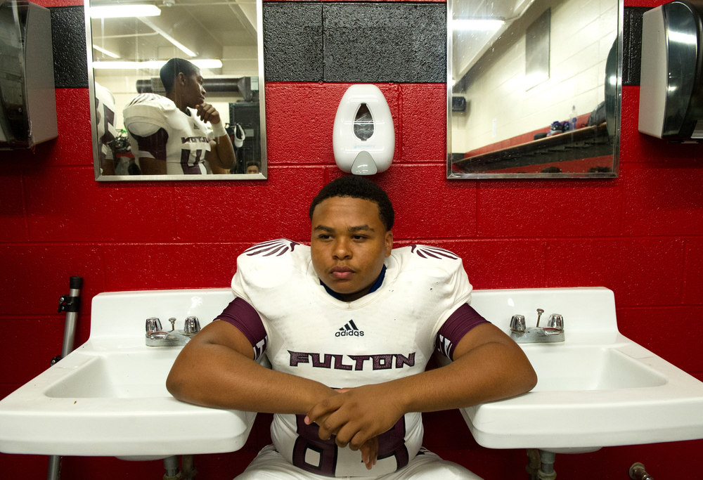 Fulton's Christian Smith gets in the zone in the locker room before the Maryville versus Fulton football game at Maryville high school Saturday, Aug. 29, 2015.
