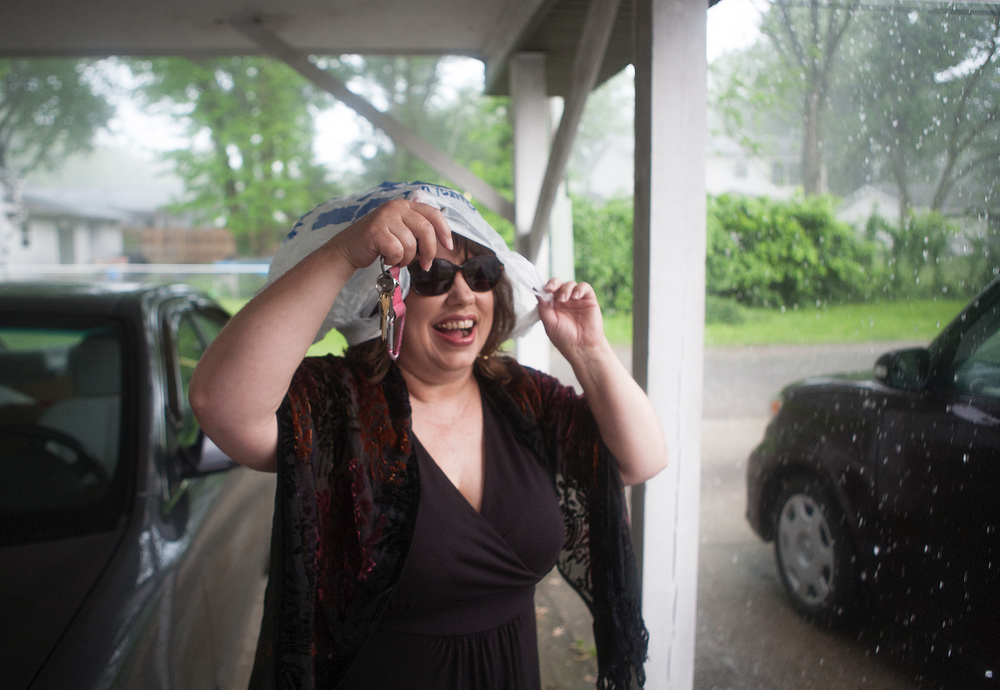 Vicki protecting herself from the rain Carbondale, May 2014.