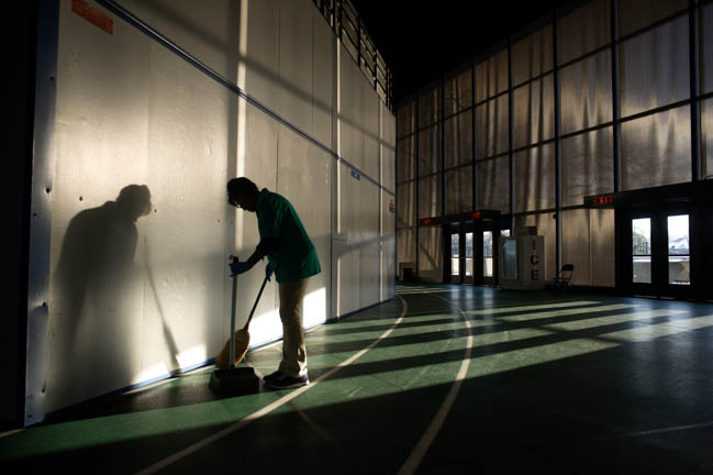 Jan Williams of Murfreesboro sweeps the floors of the Murphy Center in Murfreesboro Thursday, Mar. 5, 2015. All   state tournament basketball games scheduled to be played  today at the center were cancelled due to snow and ice accumulation last night.