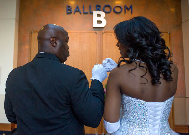 "Richard Whitt (left) tries to ease his daughter Jordan Whitt's nerves before she is presented in the AKA Debutante Ball at the Knoxville Convention Center Saturday, Mar. 28, 2015. ""The is a time when the girls are moving into a new place in their lives, but also the parents,"" said Presentation Chair Rosalyn Tillman about how preparing for the Debutante Ball is a journey that the girls and their parents take together, ""This is a special time with lots of good memories that they can have about how they worked together for this end result."""