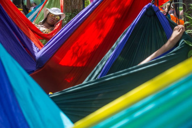 Ashley Abraham of Boston, Mass. lounges in the designated hammock area during day three of Bonnaroo Saturday, Jun 13, 2015. Abraham said she came with three other friends, but decided to go off on her own and relax.