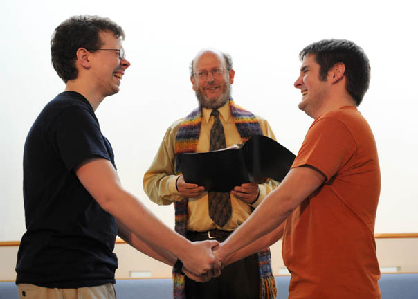 Keith Swafford of Kansas (left) and Jon Coffee of Sevierville (right) join hands as they are married by Pastor Chris Buice at the Tennessee Valley Unitarian Universalist Church in Knoxville  Friday, June 26, 2015. Swafford and Coffee are the first same-sex couple to be married in Knoxville after the Supreme Court ruled in favor of same-sex marriage nationwide.