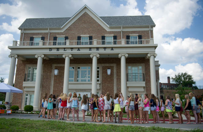 Pledges wait to enter the Delta Zeta sorority house during the first day of sorority recruitment week at the University of Tennessee Thursday,Aug. 13, 2015. Pledges spend the day visiting the 13 sorority houses where they are able to get acquainted with members, and later in the week request a sorority to join.