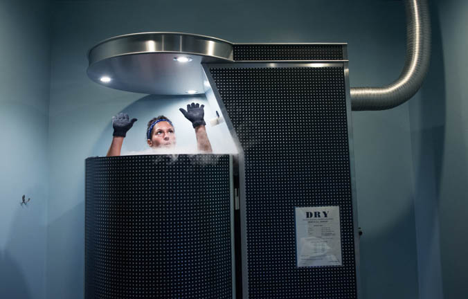 Hala Sufi raises her arms during a cryotherapy session at Ice Up Cryo on Kingston Pike in Knoxville Thursday, Oct. 8, 2015. Sufi said as a tennis instructor she gets very sore and taking cryotherapy keeps her feeling good.  When you enter the chamber liquid nitrogen is used to cool your body in three minutes or less. Owner Casey Flowers said the low temperature tricks your brain into thinking your dying and pulls all the blood into your core, runs it through your vital organs where it is enriched with oxygen and nutrients . It is recommended for people with aches and pains, and also has energy boosting side effects. Flowers said her inspiration began after hearing about cryotherapy on a podcast she and her friend decided to try it out for themselves.
