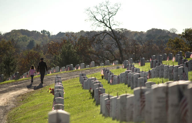A veteran and his companion walk among veterans' graves during 25th annual Veterans Day program hosted by the Tennessee Department of Veterans Services at the East Tennessee Veterans Cemetery Wednesday, Nov. 11, 2015.