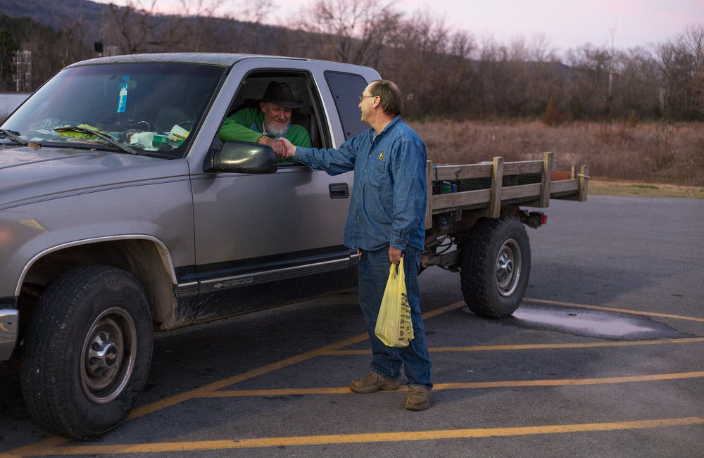 George Beaty, left, shakes the hand of Ed McClendon both of Evensville, Tenn. after running into each other at Dollar General in Evensville, Tenn. Thursday, Nov. 16 2017. Beaty said he has grown familiar with the staff at the store because he frequents it so often.