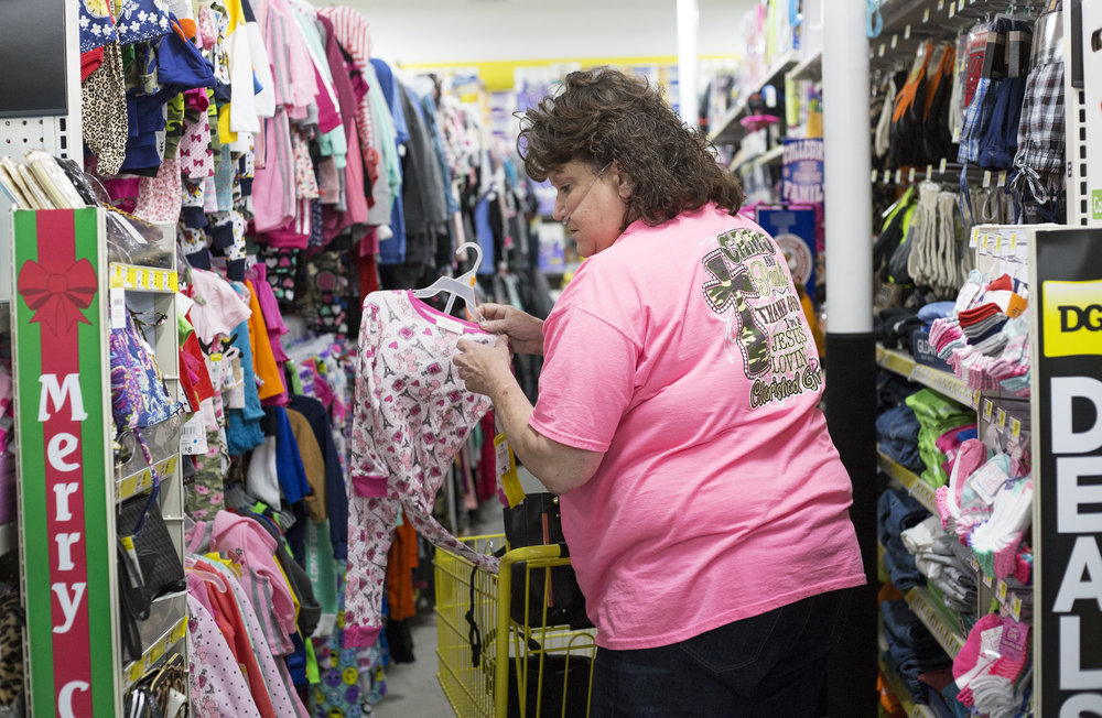 "Karen Aikman of Dayton, Tenn. shops for Christmas presents for recipients of the ""Angel Tree"" at the Restoration Clinic in Decatur, Tenn. at Dollar General in Evensville, Tenn. Thursday, Nov. 16 2017."