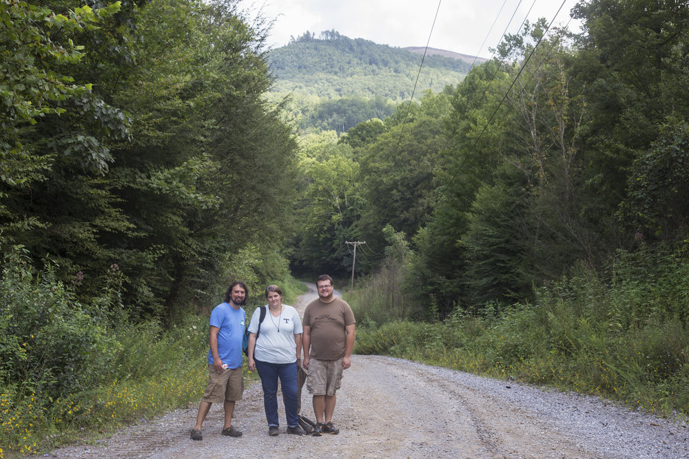Matt Hepler, left, April Jarocki and Darrell James Coker stand before a mountaintop removal site in Eagan, Tenn. Wednesday, August 16, 2017. Jarocki and Coker are volunteers, trained by Hepler, for the Clearfork Community Institute as part of the Appalachian Citizen Enforcement Project launched by the Alliance for Appalachia. The ACE trains members of Appalachian communities to collect data in an attempt to hold mining companies accountable for the contamination they cause in local waterways.