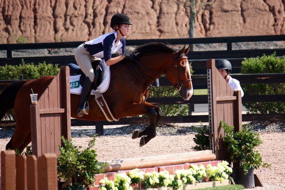 Millie Herndon schools Zetterholm at the Tryon International Equestrian Center under trainer and board member Kirstin Murphy's watchful eye.