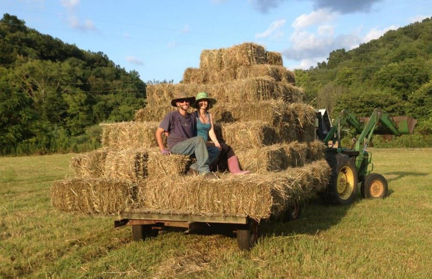 Lyle and Sam Harvey harvesting and hauling hay on a hot August day!