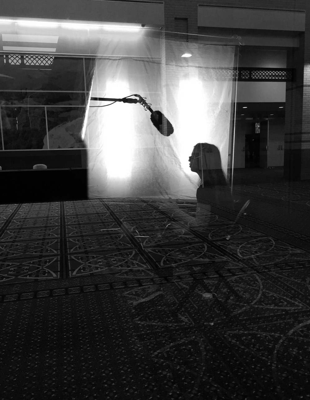 We filmed in a room with glass walls on 3 sides, providing this reflection