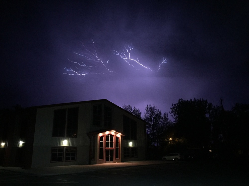 Lightning storm over the Foursquare Church in Crow Agency