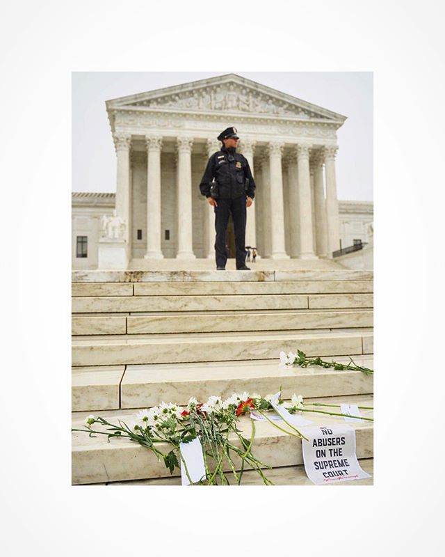 A  Supreme Court police officer stands guard over protesters gathered in support of Dr. Christine B. Ford, as Judge Kavanaugh testifies during his confirmation hearings.  #WashingtonDC #OnAssignment #sonya7iii #bealpha #politics #protesters #KavanaughHearings #MAGA #supremecourt #metoo #DC #photojournalism #CapitolHill #protest #notiphone #BreakingNews #womensmarch #BelieveSurvivors fIrewall #bythings #RainyDay #flowers