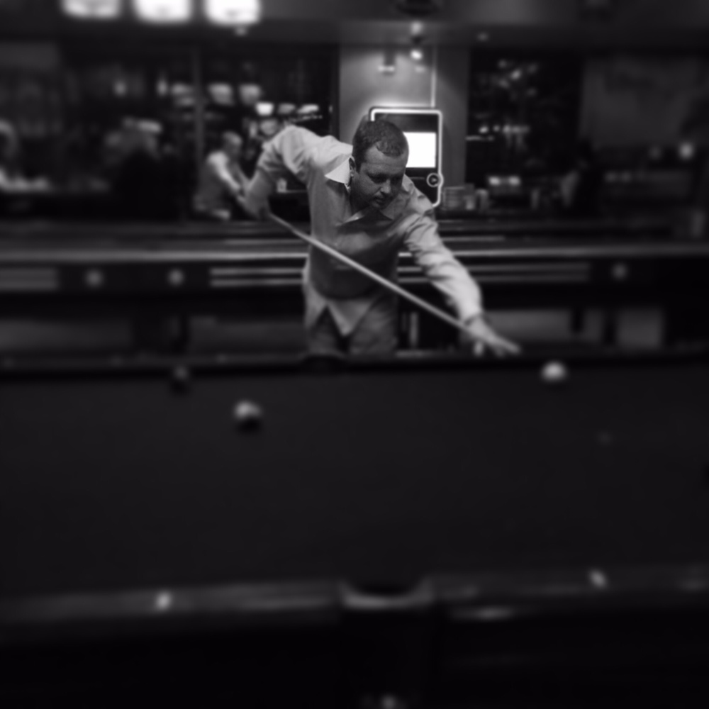 A friend playing pool