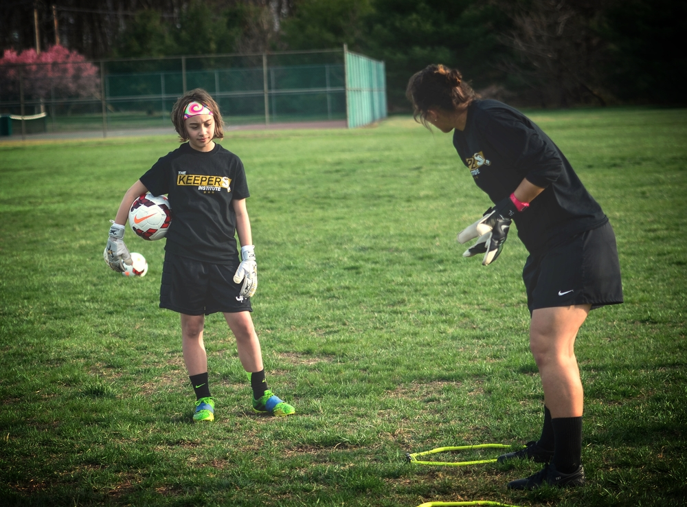 TKI student gets some individual, specific goalkeeper training.