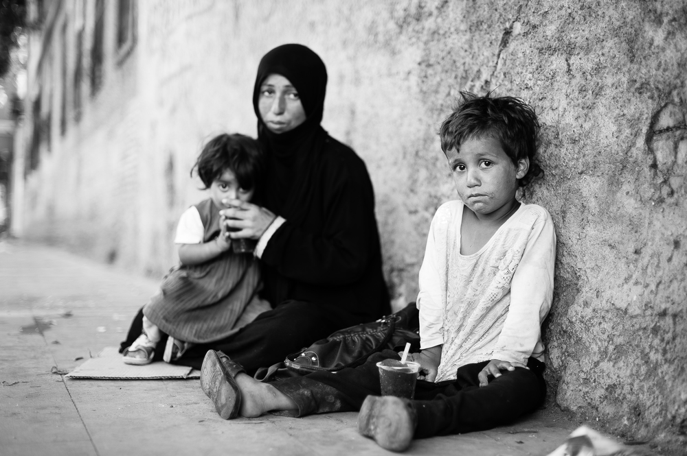 Adana ... a Syrian mother asks only milk for her children.jpg