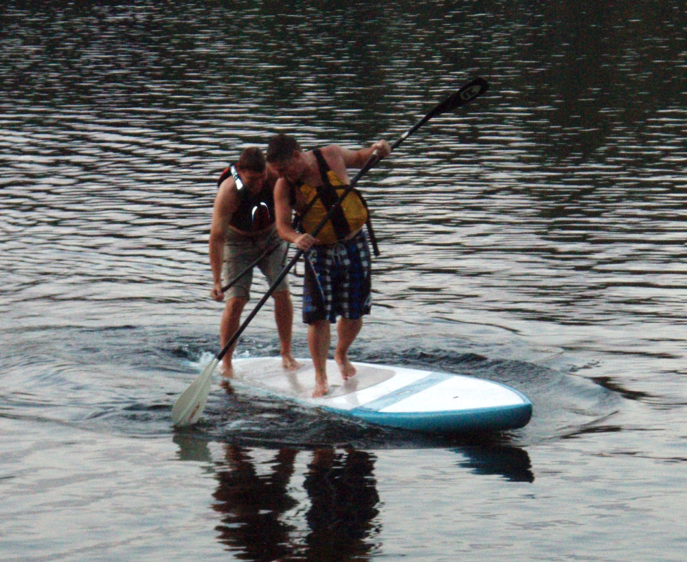 Contoocook River Canoe Co. staff having fun with a stand up paddleboard on the Merrimack River.