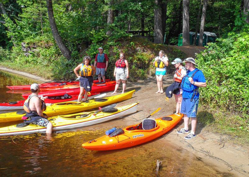 Instructor Jeff with Introduction to Kayaking Course participants on the shore of the Contoocook.