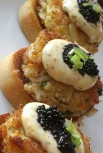 Petit crab cakes, lemon aioli, caviar garnish and fresh cilantro.