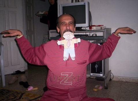 Dr. Samir Nasrallah making sure his daughters laugh with a  little help from Flat Stanley.