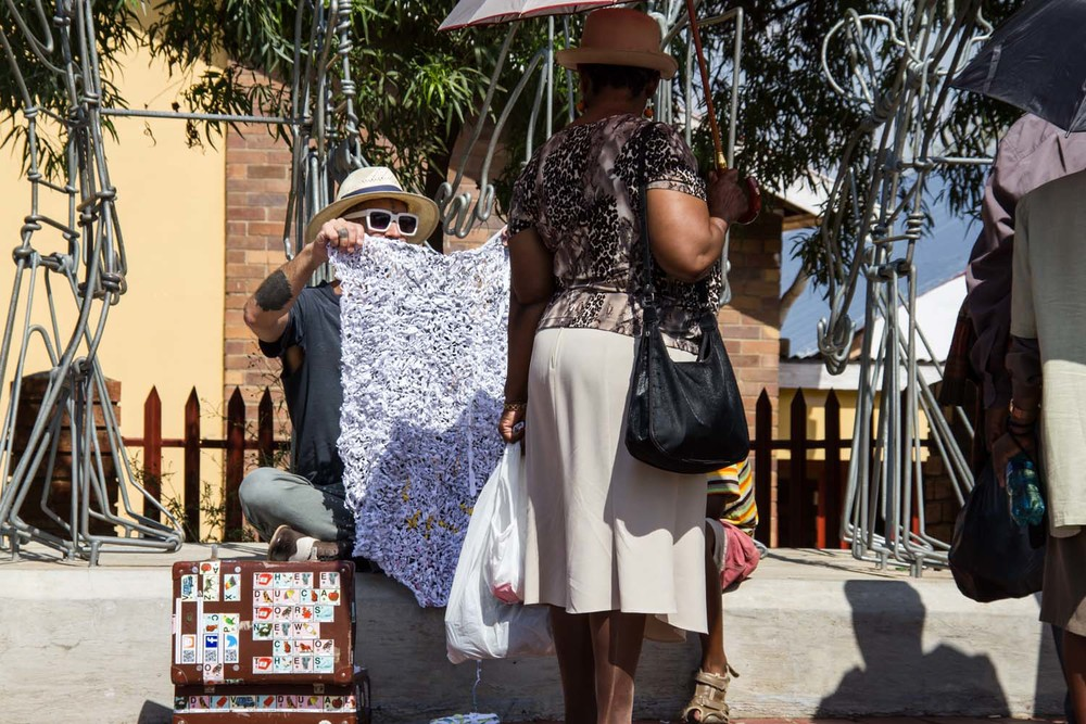 Knitting with 'Student Confrontation' public sculpture by Stone Mabunda, Vilakazi St, Soweto, 27 February 2014, Image- Mark Rautenbach, Photographer- Popskiet