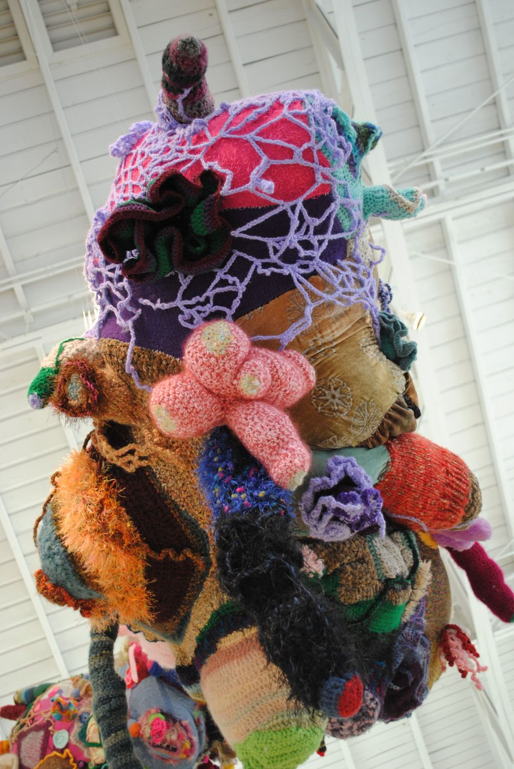 "Untitled (The Shapes of My Dreams and of My Nightmares),  Detail. 2013, Yarn, fabric, heirloom clothing, faux fur, thread, fiberfill. 61"" x 41""   x 32""   (dimensions variable) Courtesy of the artist."
