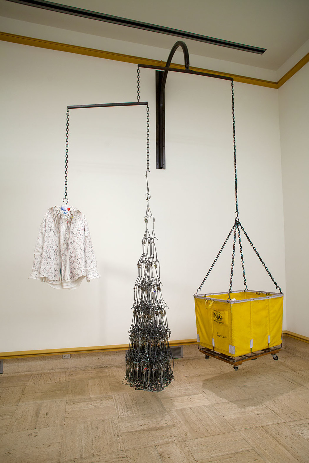 Untitled, Found Objects; Shirts, Hangers, Chains, Steel, Cart Dimensions Variable, 2013.