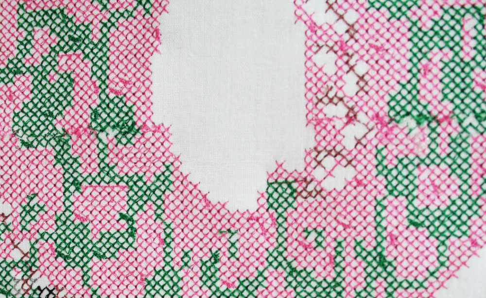 "Detail of a 14"" x 14"" cross-stitch created on a 10 -needle embroidery machine for DigiFab resident Asheer Akram"