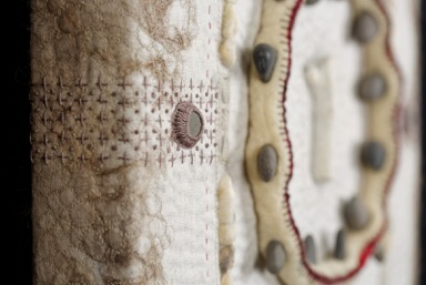 "Detail.   ""Vein #3"" (16"" x 16"" x 2"") Vintage domestic linens, unspun wool fiber, silk organza mesh, found objects. Hand felted, machine & hand embroidered, hand quilted, upholstered onto cradled board, 2015. Image courtesy of the artist."