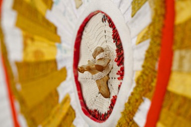 "Detail. ""Reliquary #3: I Will Catch You"" (25.75"" x 25.75"") Vintage domestic linens, silk organza, wool, abandoned embroideries & quilts, found object. Machine pieced, hand embroidered & quilted, 2015. Image courtesy of the artist."
