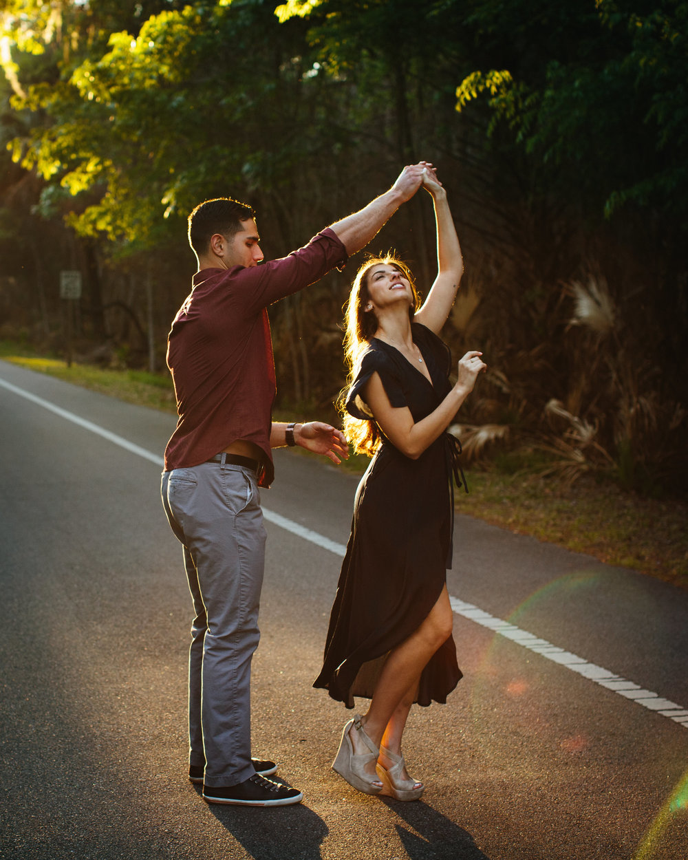 dancing laughing engagement session