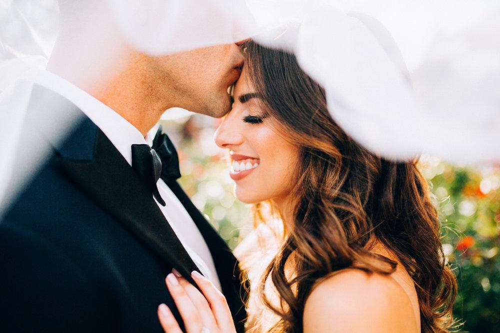 Groom Giving Bride Forehead Kiss under veil Armature Works Tampa Florida